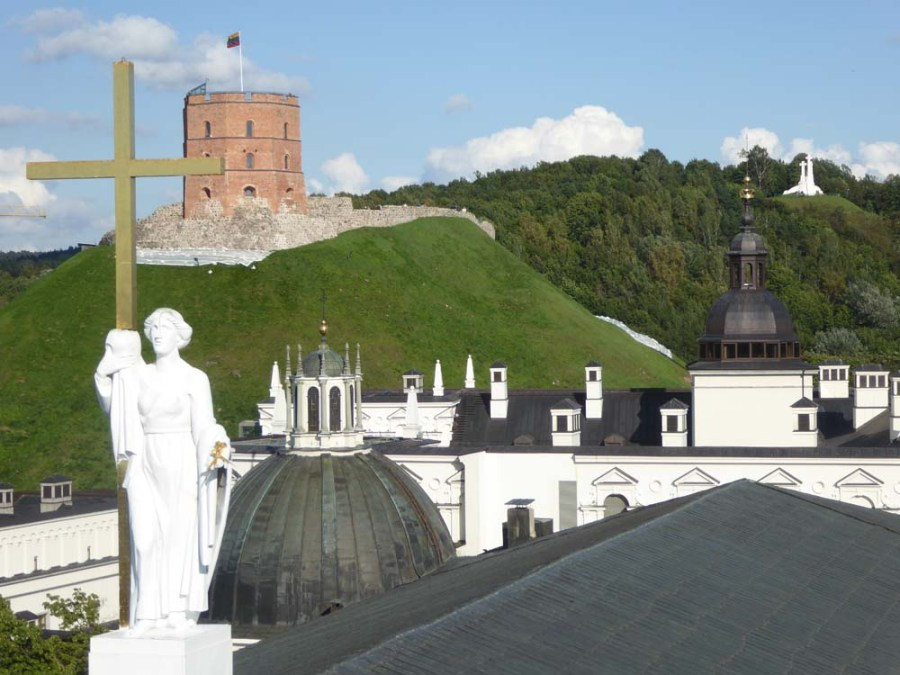 LITHUANIA - View across the cathedral roof to the castle and martyr site in Vilnius