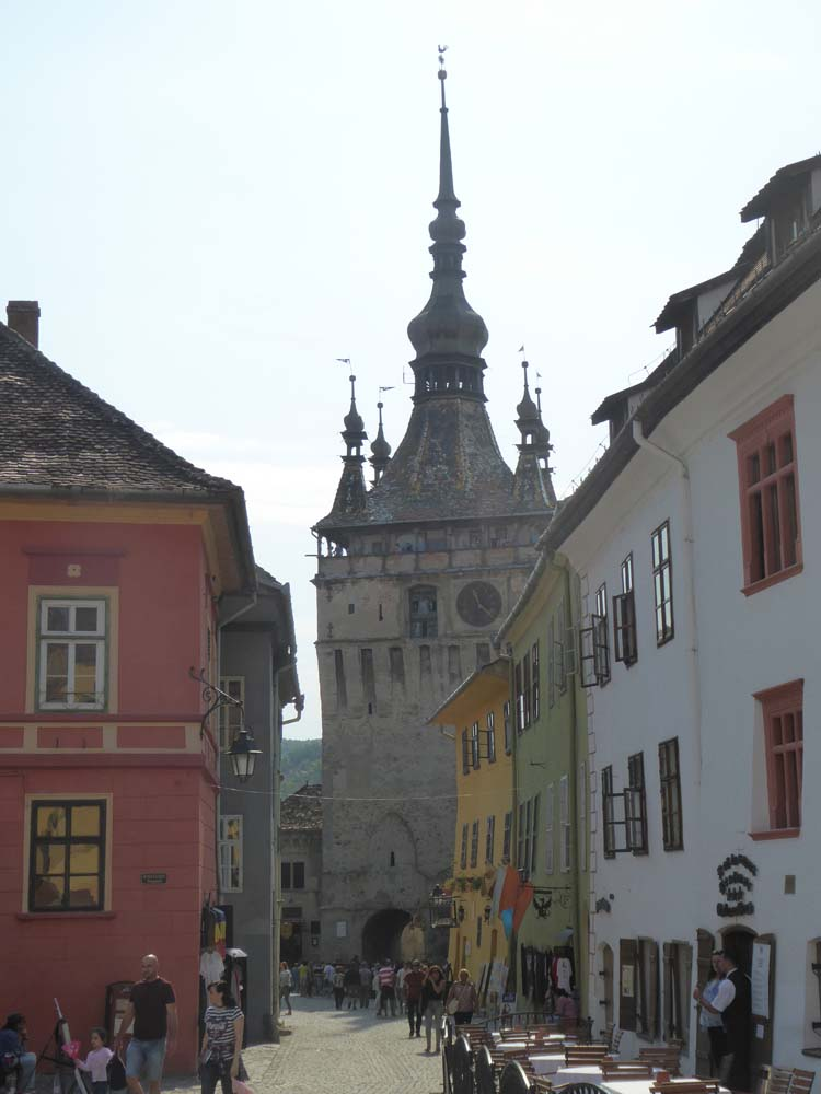 ROMANIA - Sighisoara medieval village, with clock tower and Vlad Dracul house (yellow)
